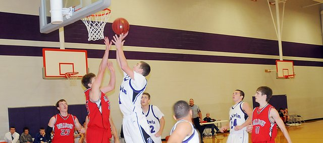 Baldwin High School senior Alex Twombly, center, scores a layup Tuesday night against Anderson County. Twombly received a pass from sophomore Cornell Brown, foreground. Baldwin won the game 49-34, advancing to the championship game of the Bulldog/Wildcat Classic, which begins at 7:30 p.m. Friday in Louisburg. Twombly scored nine points in Tuesday's victory.