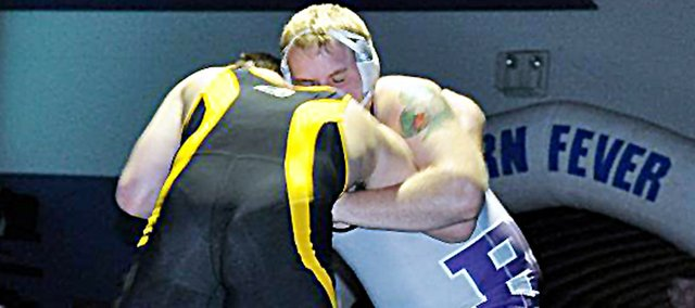 Baldwin High School senior Colton Bonner, right, wrestles in the 220-pound championship match Saturday. Bonner lost to a three-time state finalist from Iowa, but his second-place finish did lead all Bulldogs at the Gardner-Edgerton Invitational.