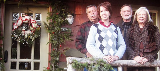 Randy and Julie Bear (right) and Tom and Bonnie Plumberg stand on the porch of the Bear home decorated for the season and Sundays holiday home tour.