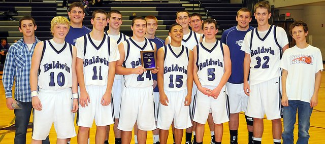 The Baldwin High School basketball team won the Bulldog/Wildcat Classic Friday night with a 40-35 victory over Iola. The win improves the Bulldogs to 4-0 on the season.