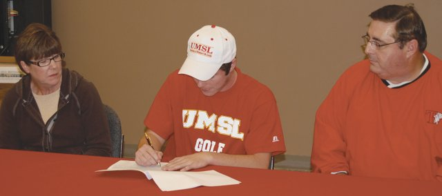 Tonganoxie senior Colby Yates, center, recently signed a national letter of intent to play golf at the University of Missouri-St. Louis.