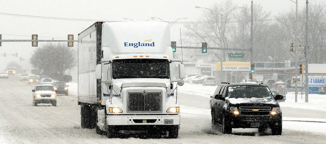 Drivers make their way down Shawnee Mission Parkway in this 2008 file photo. With December under way and winter on the horizon, the Kansas Highway Patrol is sending some reminders about traveling in snowy and icy conditions.