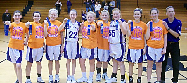 Baldwin Junior High School's eighth-grade junior varsity basketball squad went a perfect 10-0 this season and were the Frontier League Champions. Pictured, from left, are Erica Petry, Emily Weiss, Emma Burnett, Mackenzie Russell, Ashleigh Kramps, Mackenzie Ellis, Samantha Brinkmann, Katie Behrens, Analise Gill and coach Dane Jorgensen. Not pictured is Amber Garrett.