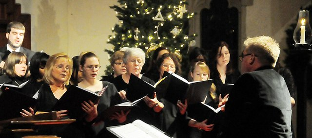 Matthew Potterton directs the Baker Community Choir during its performance at the universitys Candlelight Vespers Concert earlier this month. Potterton started the choir of Baker students and area residents nearly two years ago.