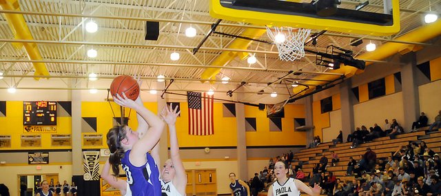 Baldwin High School junior Katie Kehl puts up a guarded shot along the baseline Tuesday. Kehl scored nine points to help the Bulldogs beat rival Paola 56-47.