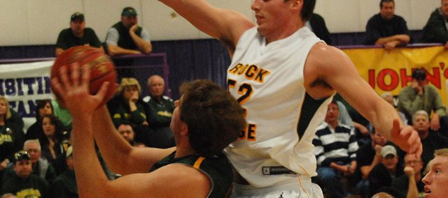 Basehor-Linwood's Colin Murphy draws a foul against Columbia (Mo.) Rock Bridge. BLHS trailed by 13 points in the second half but stormed back to win 67-60 in overtime at the Hy-Vee Shootout.