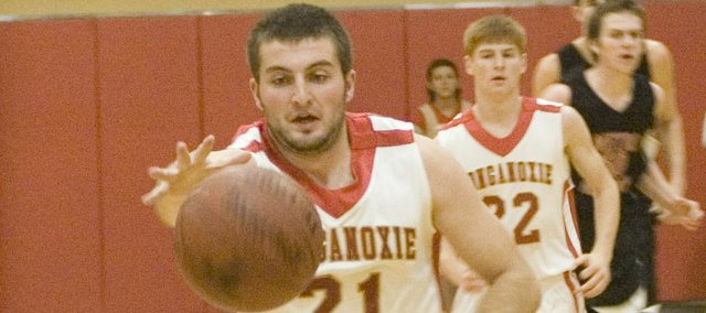 Senior Brady Waldeier goes after a loose ball in Tonganoxie's 51-33 win over Metro Christian Academy on Tuesday.