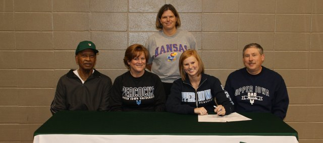 Brooke Redmond, Basehor-Linwood senior pitcher, recently signed a letter of intent to play college softball at Upper Iowa University in Fayette, Iowa. Pictured at the signing ceremony are, seated, from left: pitching coach Chuck Waters; Jeane Redmond, mother; Brooke Redmond; Larry Redmond, father; and, standing, BLHS coach Susan Mayberry.