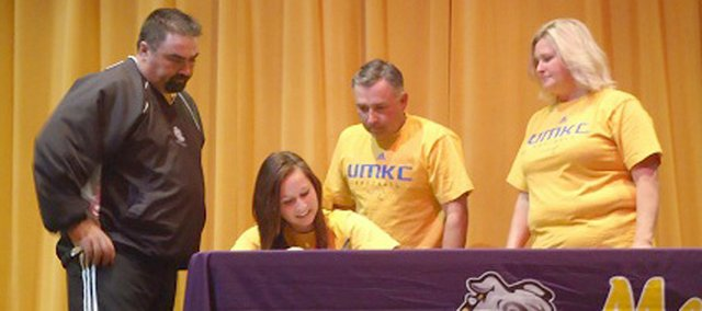 McLouth High senior Kendra Leach, seated, recently signed a national letter of intent to play softball at the University of Missouri-Kansas City. Pictured from left are MHS coach Ballard Patterson, Kendra Leach, Robert Leach and Paulette Leach.