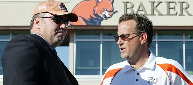 Baker University alumnus Mike McCarthy, left, chats with Wildcats head football coach Mike Grossner during his visit back to Baker in the fall of 2008. McCarthy and Grossner were teammates at Scottsdale Community College (Ariz.). McCarthy coached the Green Bay Packers, who won last year&#39;s Super Bowl.