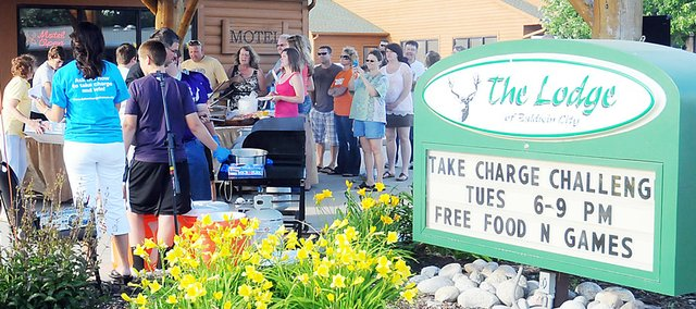 Baldwin City hosted a free community-wide cookout at The Lodge on June 21 for the Take Charge Challenge. Baldwin City won the energy-efficiency contest and a $100,000 grant toward energy savings.