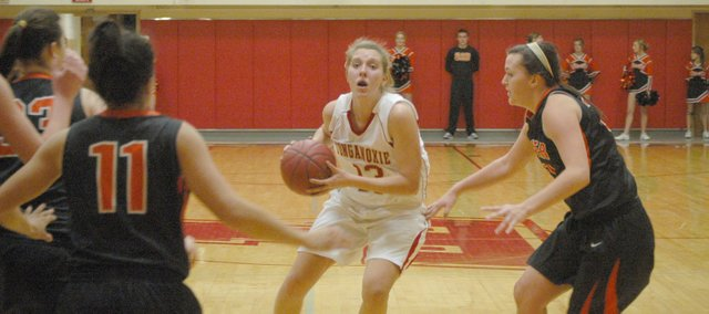 Sophomore Emma Stilgenbauer looks for an open teammate under the basket on Tuesday.