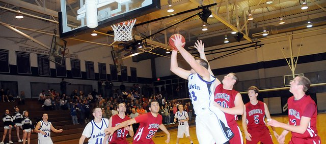 Baldwin High School junior Dayton Valentine scores a basket during the Bulldogs game on Dec. 20. Both BHS varsity teams have been practicing hard over winter break to prepare for the remaining two months of their seasons.