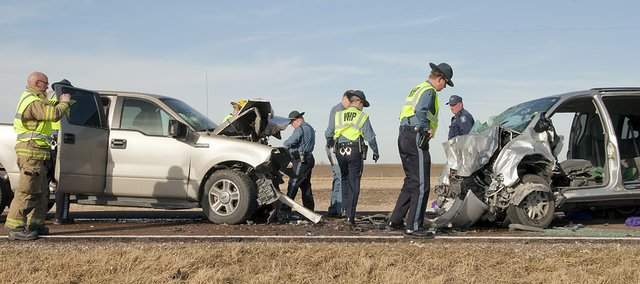 Kansas Highway Patrol troopers investigate the scene of an accident that sent two people to the hospital Tuesday, Jan. 3, 2012 on U.S. Highway 56 west of Baldwin City.