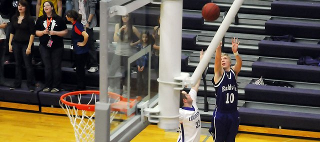 Baldwin High School senior Britton Schroeder attempts a three-pointer over a Louisburg defender Friday night. Schroeder scored eight points in the Bulldogs' 49-26 victory.