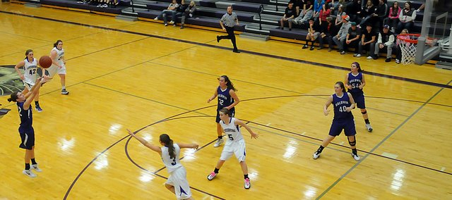 Baldwin High School sophomore Katie Jones, left, shoots a three-pointer during a Bulldogs&#39; fast break Friday at Louisburg. Jones led all scorers with 15 points as the Bulldogs beat the Wildcats 41-25.
