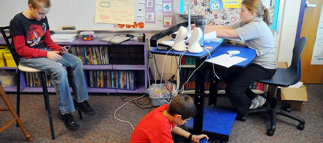 A trio of Baldwin Elementary School Intermediate Center fifth-graders use Apple iPod Touches during their daily alloted time. All three students are in Kathy Dorsey's class. Dorsey purchased three iPods this year and last for her class with money from the Baldwin Education Foundation Innovative Grants. The students, from left, are Dylan Thompson, Zach Waltz and Ashlyn Vigna.