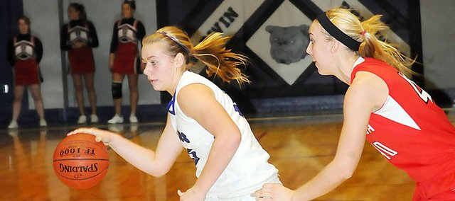 Jessie Katzer, Baldwin High School junior, dribbles around her defender Tuesday night. BHS lost the game to Ottawa, 38-19.