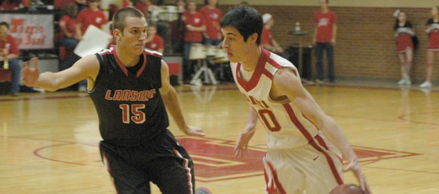 Tonganoxie's Dylan Jacobs drives against Lansing's Clay Young.