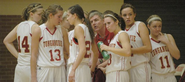 Coach Randy Kraft, center, gives the Tonganoxie girls instructions during a timeout.