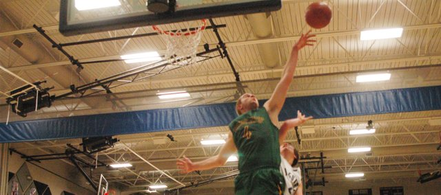 Basehor-Linwood senior Colin Murphy blocks a shot during the Bobcats' victory at Mill Valley on Friday.