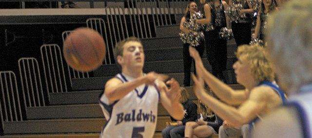 Baldwin sophomore Chad Berg passes the ball to senior Tucker Brown during the Bulldogs' first-round victory over the Perry-Lecompton Kaws. With the win, Baldwin will play Friday against Augusta. The game is slated for a 8:30 p.m. tip.