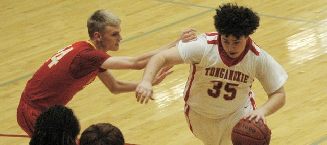Tonganoxie's Brennan Williams dribbles around Atchison's Blake Dykstra.