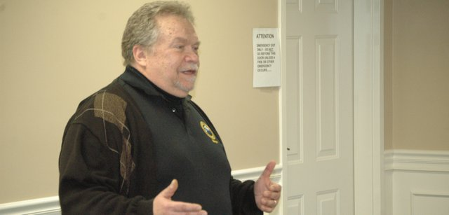 Basehor Mayor Terry Hill speaks to the Basehor Chamber of Commerce during his 2012 State of the City address  Thursday at Community National Bank in Basehor.