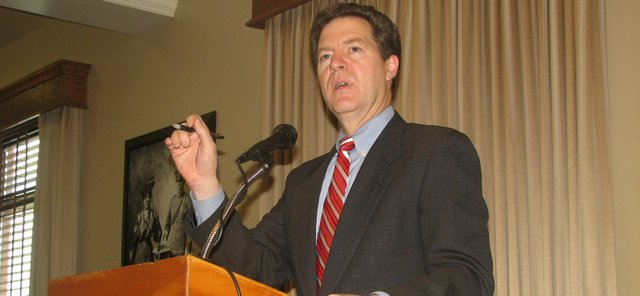 Gov. Sam Brownback speaks during the Leavenworth County Development Corporation's annual meeting at the Riverfront Community Center in Leavenworth on Friday, Jan. 20.