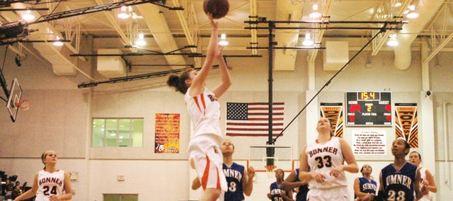 Junior Anna Deegan attempts a layup during Bonner Springs' 58-28 victory against Sumner Academy. Deegan led the team with 18 points on the night of her birthday.