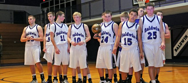 The Baldwin Bulldogs accept the second-place trophy after falling to Bonner Springs 47-32 in the finals of the Baldwin Invitational Tournament. It was the third-straight year, the Braves have beaten the Bulldogs in the championship game.