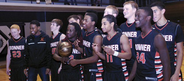 The Bonner Springs Braves accept the first-place trophy after downing Baldwin 47-32 in the finals of the Baldwin Invitational Tournament. It was the third-straight year, the Braves have beaten the Bulldogs in the championship game.