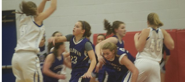 Baldwin's Kailyn Smith and Jessie Katzer battle to get to a St. Mary's shooter during the Bulldogs 49-40 victory Tuesday in the first-round of the Wellsville Top Gun Tournament.