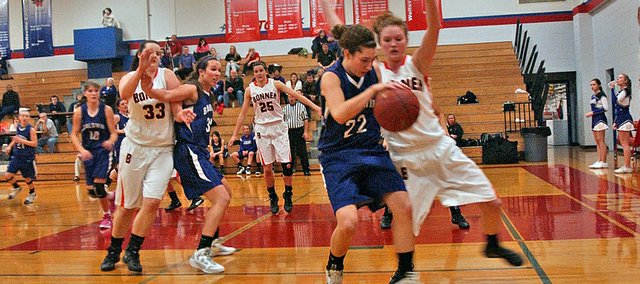 Bonner Springs junior Anna Deegan pressures Baldwin junior Katie Jones in the teams' second-round game of the Wellsville Top Gun Tournament. Bonner Springs won 51-25.