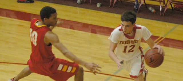 Tonganoxie's John Lean drives against Atchison's Clayton Bratton