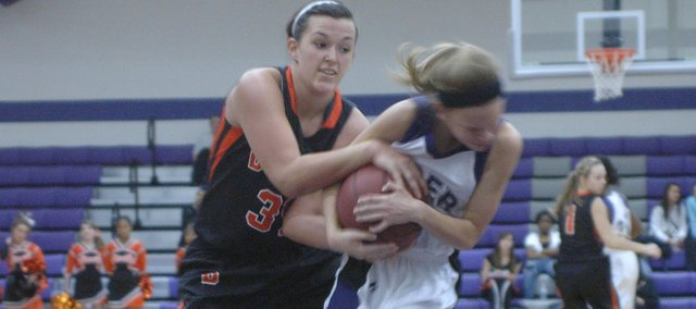 Senior Erin Marx wrestles for a possession Tuesday against Piper. Bonner Springs erased a halftime deficit to remain perfect at 13-0. Over the weekend, the Braves won the Top Gun Tournament — also in come-from-behind fashion — defeating Spring Hill, 48-40, in the championship.