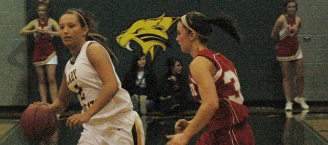 Basehor-Linwood&#39;s Haley Waters, left, drives against Tonganoxie&#39;s Hannah Kemp.