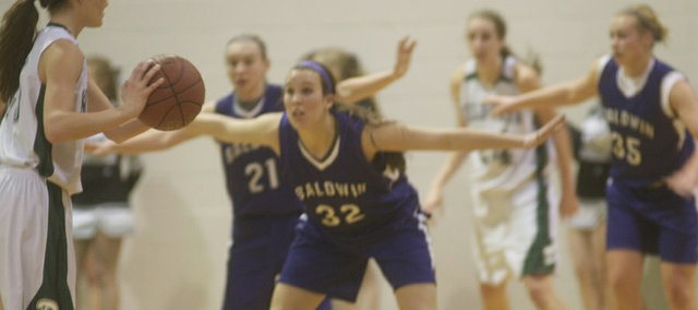 Baldwin's Callie Enick stretches out to fill passing lanes during the Bulldogs overtime win against De Soto.