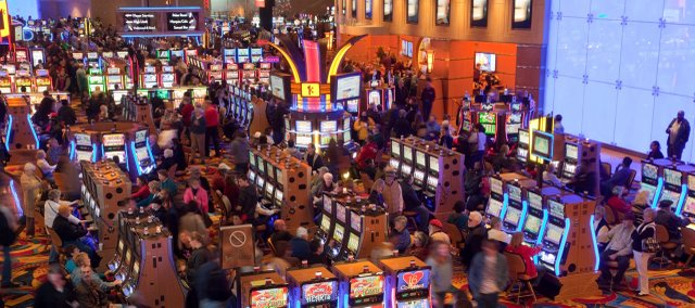 Gamblers take to the slots on the opening day of the Hollywood Casino at Kansas Speedway.