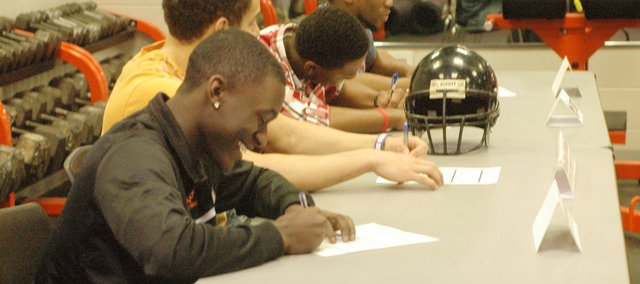 Four Bonner Springs football players signed letters of intent to continue their careers at respective community college programs. Daemon Franklin (Butler Community College), J.J. Jackson (Coffeyville Community College), Stevie Williams (Butler Community College) and JaVante Young (Fort Scott Community College) made their college choices official on Wednesday in front of parents, coaches and peers.