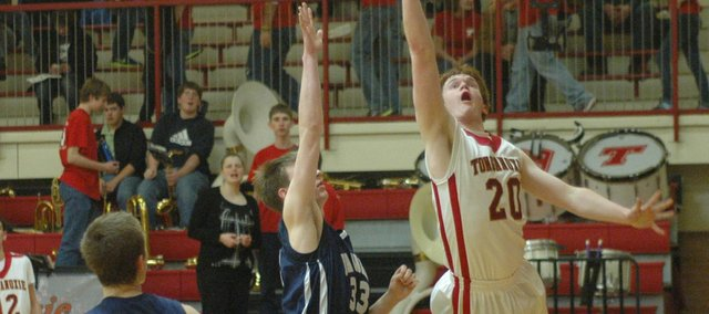 Tonganoxie's Dane Erickson puts up a shot over Mill Valley's Nathan Stacy.