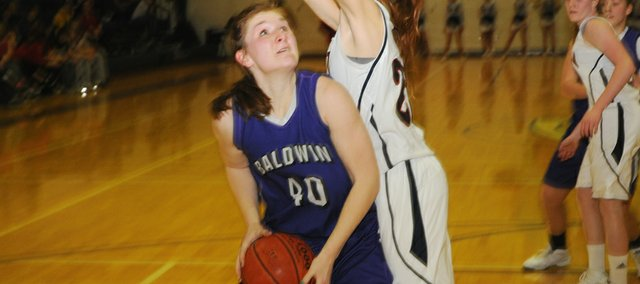 Baldwin junior Katie Kehl posts up for two of her 13 points in the Bulldogs 47-32 victory Tuesday on the road in Eudora. Kehl also grabbed 15 rebounds in the game.