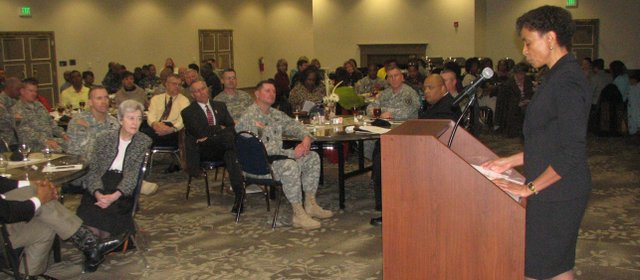Kansas University Chancellor Bernadette Gray-Little addresses a crowd of about 200 people, mostly Army officers, during a Black History Month luncheon at Fort Leavenworth's Frontier Conference Center on Thursday. Gray-Little spoke about the military's history of advancements on civil rights.