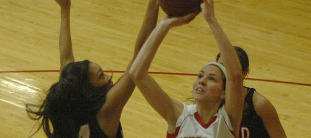 Tonganoxie's Jenny Whitledges puts up a shot against Bishop Ward's Frankie Oropeza.