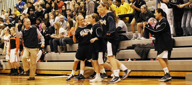 Mill Valley girls basketball coach John McFall reacts to defeating previously-unbeaten Bonner Springs on Friday.