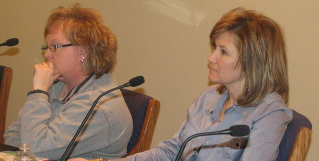 New Basehor-Linwood school board member Shelley Stevens (right) takes her seat alongside board president Dayna Miller after being appointed Monday night. Stevens replaces Wynne Coleman, who resigned in November because of a job-related move.