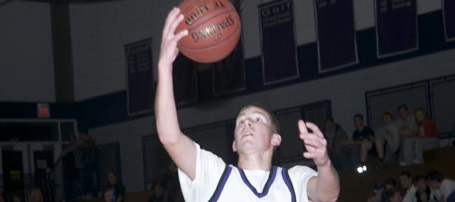 Baldwin senior Alex Twombly scores on a layup after stealing the ball off the press in the Bulldogs' victory Tuesday over Paola.