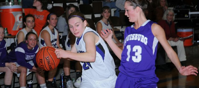 BHS junior Kaitlin Jorgensen drives to the basket during the Bulldogs second-half comeback Tuesday against Louisburg. The rally fell short as Baldwin lost, 40-39.