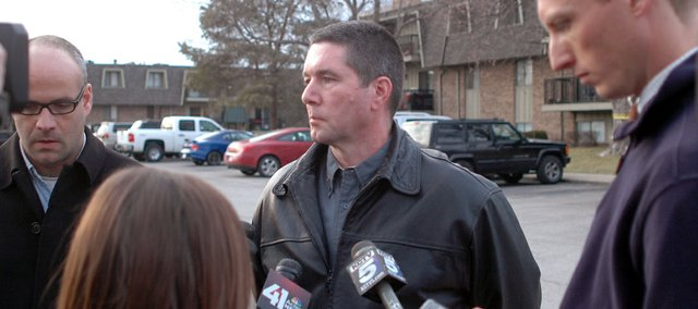 Shawnee Fire Chief John Mattox takes questions from reporters outside the apartment building where an early-morning fire killed two residents. Food left on the stove caused the fire, which started about 5:30 a.m. Friday at the Carlyle Apartment Homes, 11601 W. 75th Terrace, and accounted for Shawnees first citizen fatalities from a fire in more than 10 years, Mattox said.
