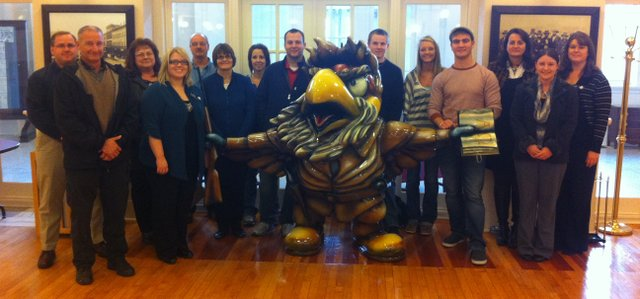 Members of this year's Southern Leavenworth County Leadership Development Class stand with John Brown Hawk at the Journal-World News Center in Lawrence. Pictured are, from left, Andy Dedeke, Jeff Brandau, Sharon Tuttle, Allison Overby, Roger Vinzant, Diana Weaver, Leigh Farris, Brad Eccles, Skyler Barnes, Sydne Ericksen, Jonas Myers, Denise Johnson, Heather Van Dyke and Jennifer Bizzell. Not pictured are Timothy Dossey and Curt Wright.